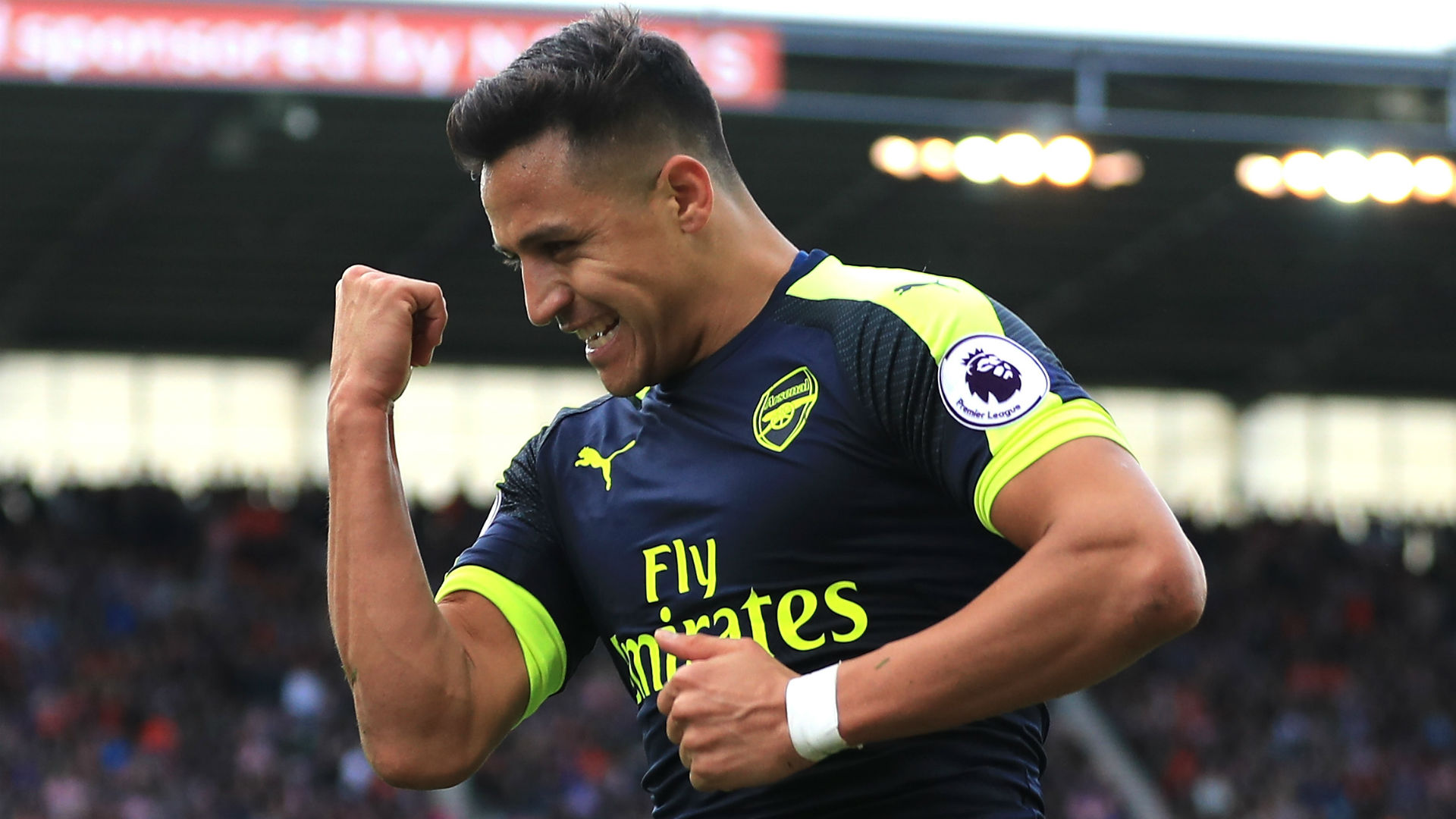 Wenger praises'fighter Sanchez for playing through the pain