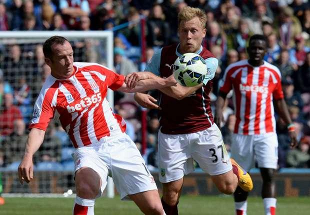 Stoke City's Charlie Adam battles with Scott Arfield of Burnley