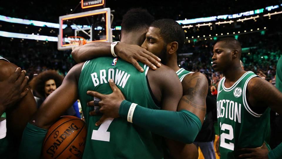 Kyrie Irving, right, hugs Jaylen Brown.