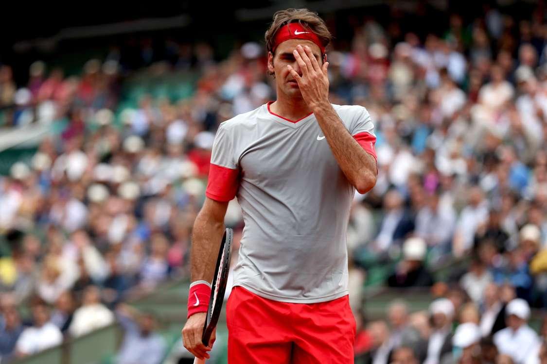 Federer out as Djokovic, Murray progress