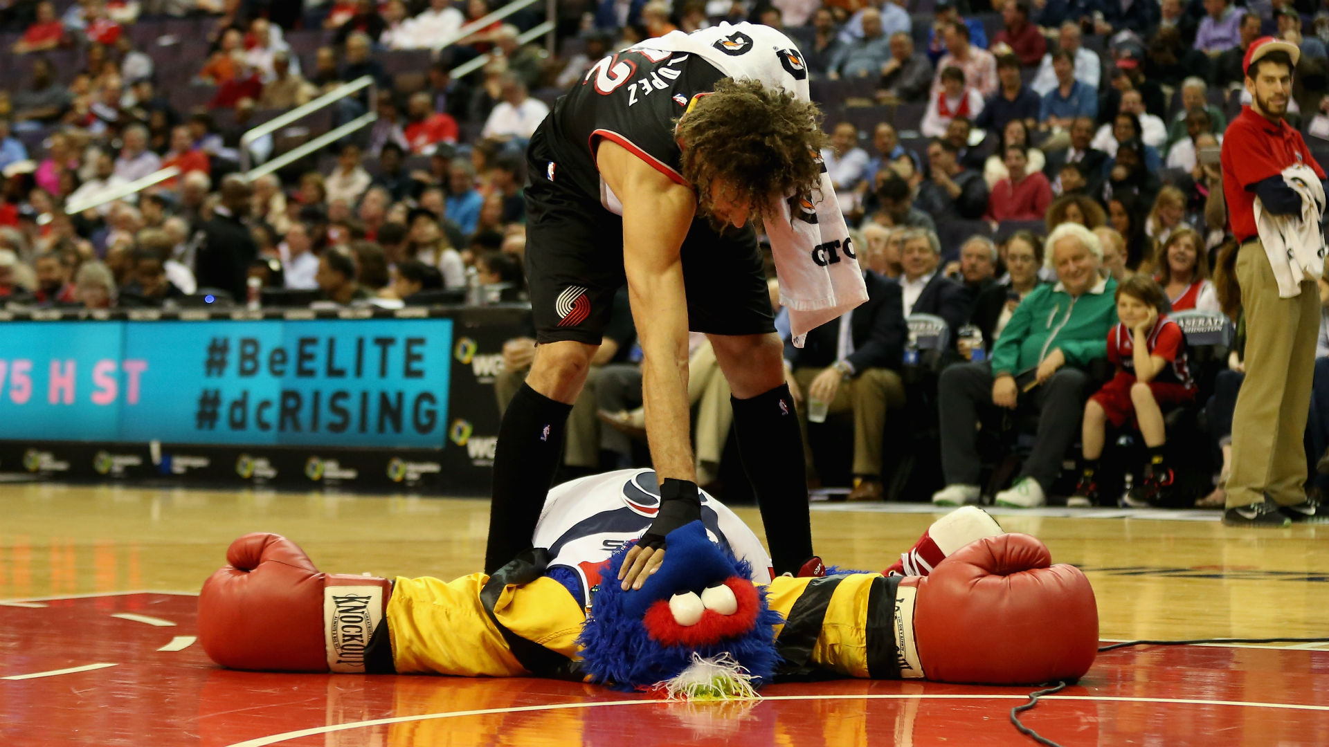 WATCH: Bulls' Robin Lopez knocks Raptors' mascot down in response to joke