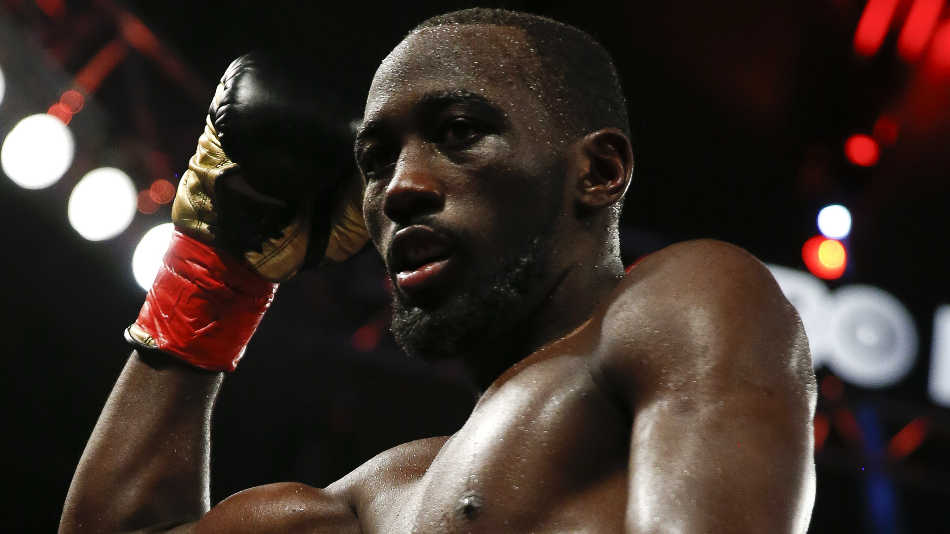 Terence Crawford makes history, unifies 140-pound titles with third-round knockout