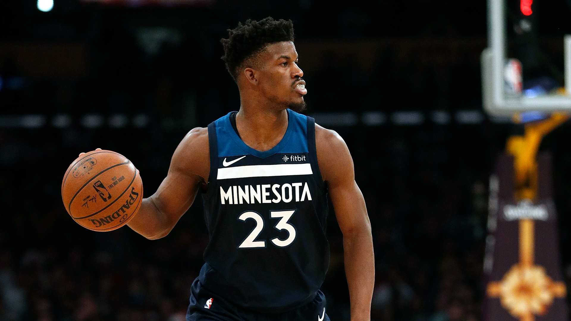 Timberwolves' Jimmy Butler (right leg) helped off the court on Friday night