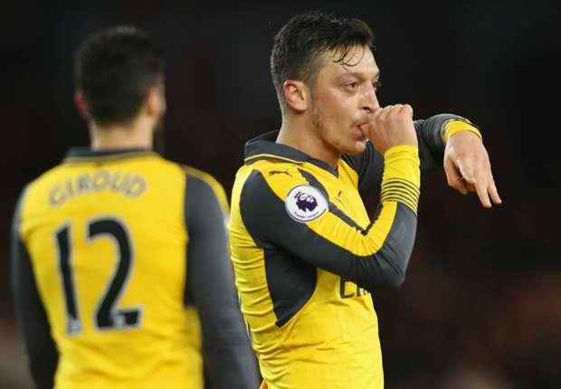 Arsenal midfielder Mesut Ozil celebrates against Middlesbrough