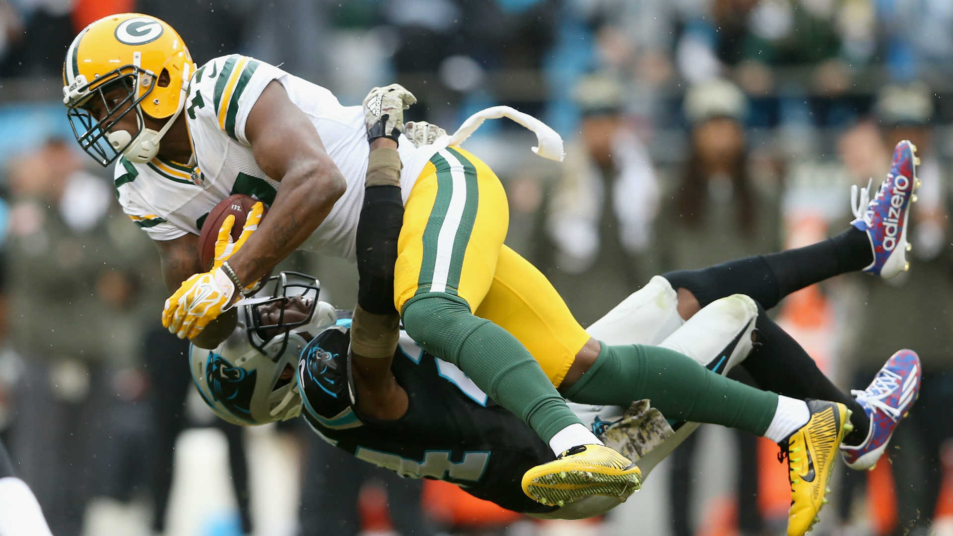 Josh Norman tackling Davante Adams