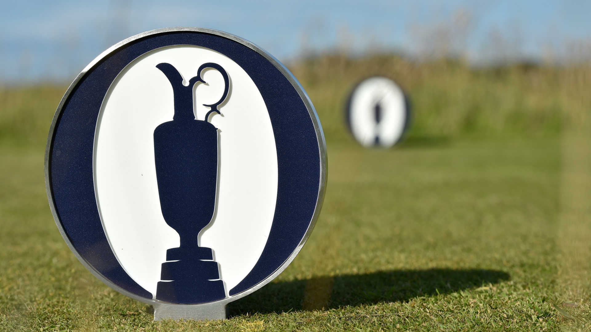 Claret Jug logos on tee boxes at St. Andrews.