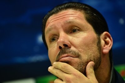 Simeone expecting tough Milan test