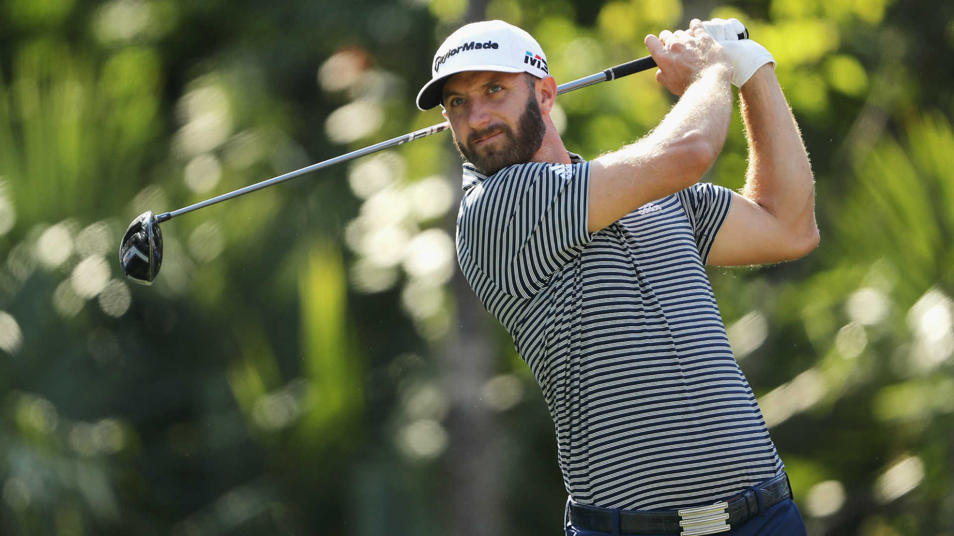 Johnson headlines crowded leaderboard at Players Championship