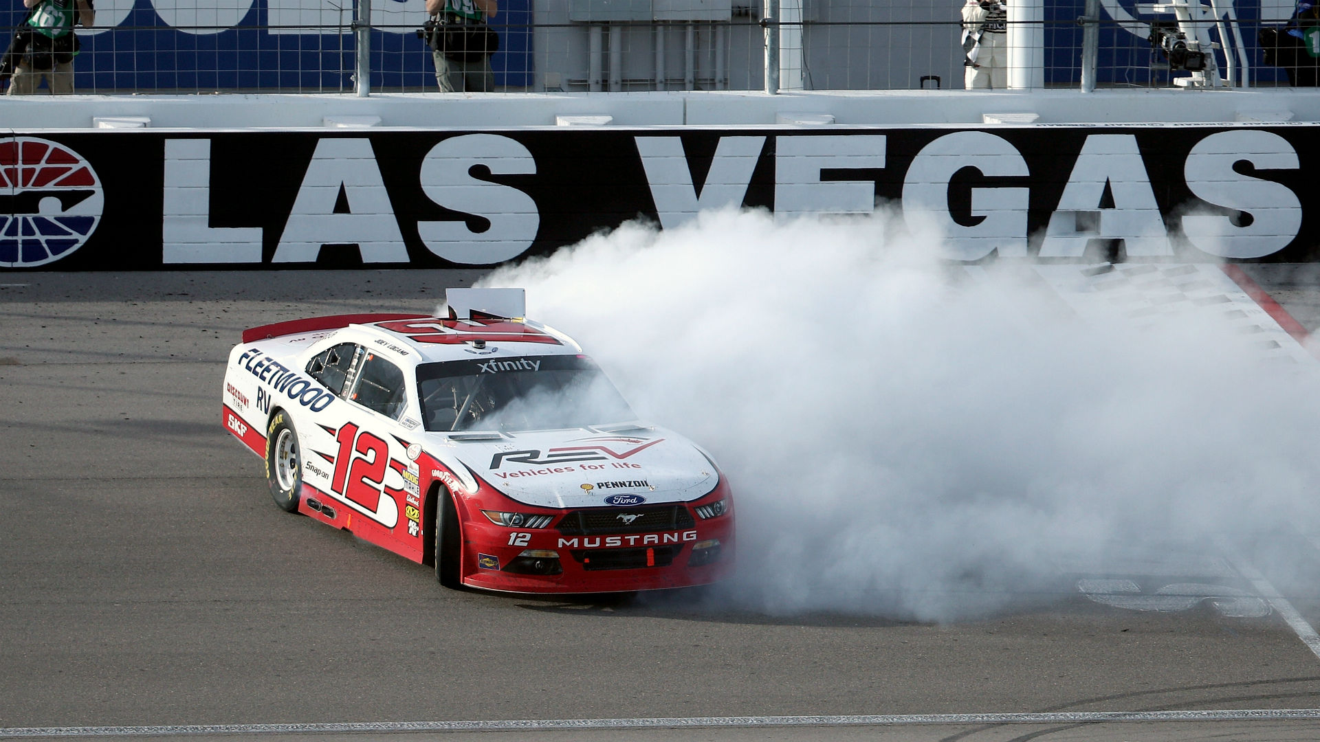 Truex wins at Vegas, Busch and Logano brawl