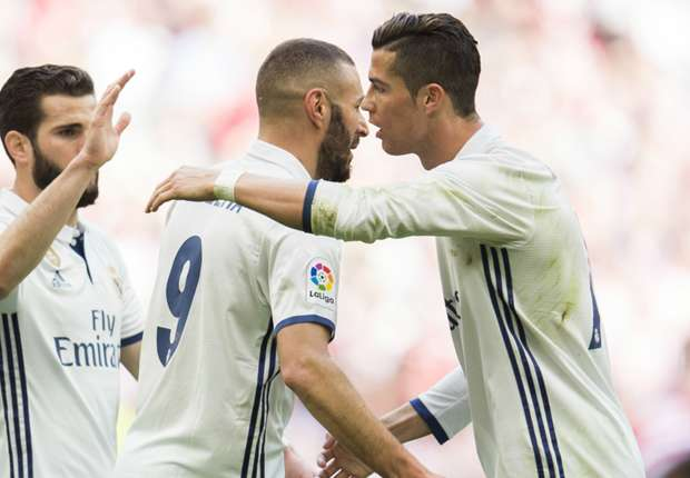 Karim Benzema celebrates with Cristiano Ronaldo at San Mames