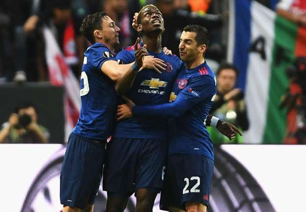 Paul Pogba celebrates with Matteo Darmian (L) and Henrikh Mkhitaryan