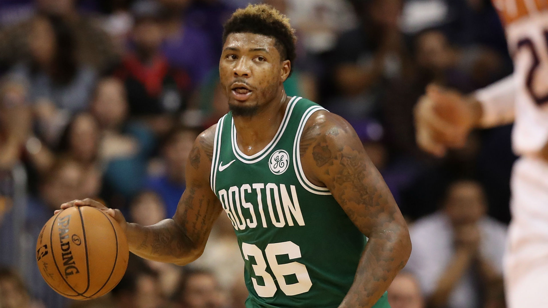 Celtics G Marcus Smart has to be held back from going after Hawks' DeAndre' Bembry