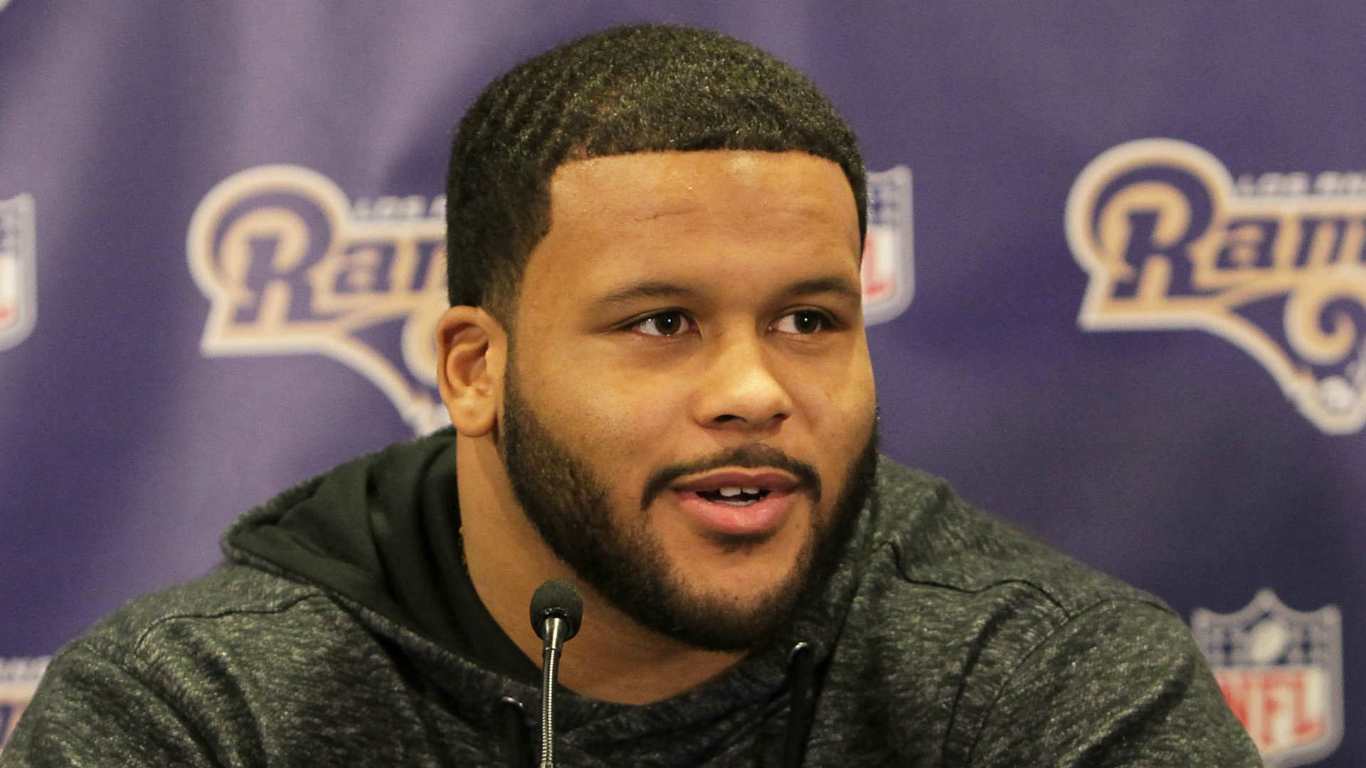 Aaron Donald ends Rams holdout won t play in opener