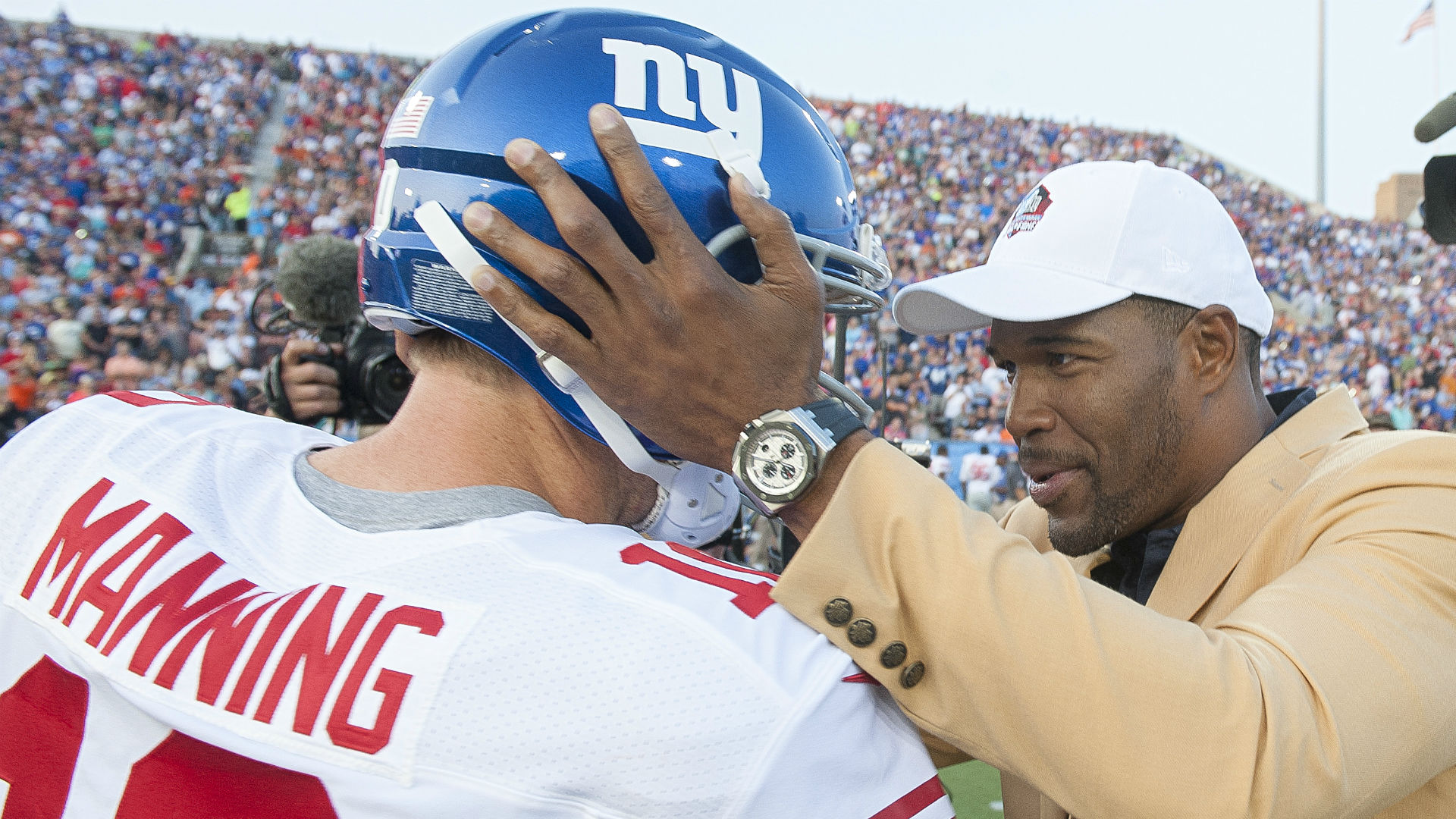 http://images.performgroup.com/di/library/omnisport/70/96/eli-manning-and-michael-strahan_1u5thyw1fh3lx12uf2b8t14utm.jpg