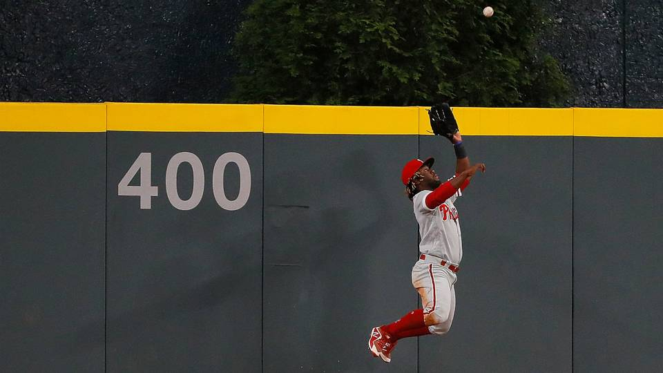Watch Phils Cf Odubel Herrera Goes Over Fence To Rob Freddie