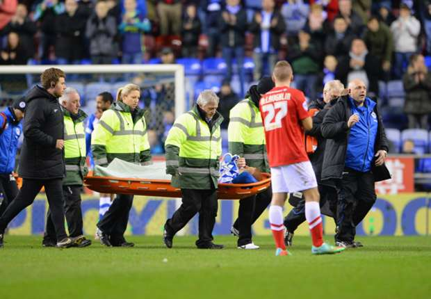 Wigan midfielder Watson suffers double leg fracture
