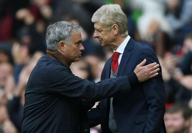 Jose Mourinho greets Arsene Wenger at Old Trafford.