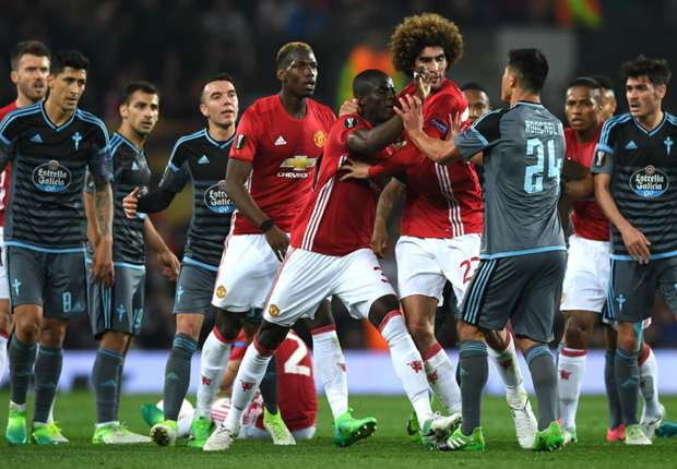 Manchester United and Celta Vigo players clash at Old Trafford