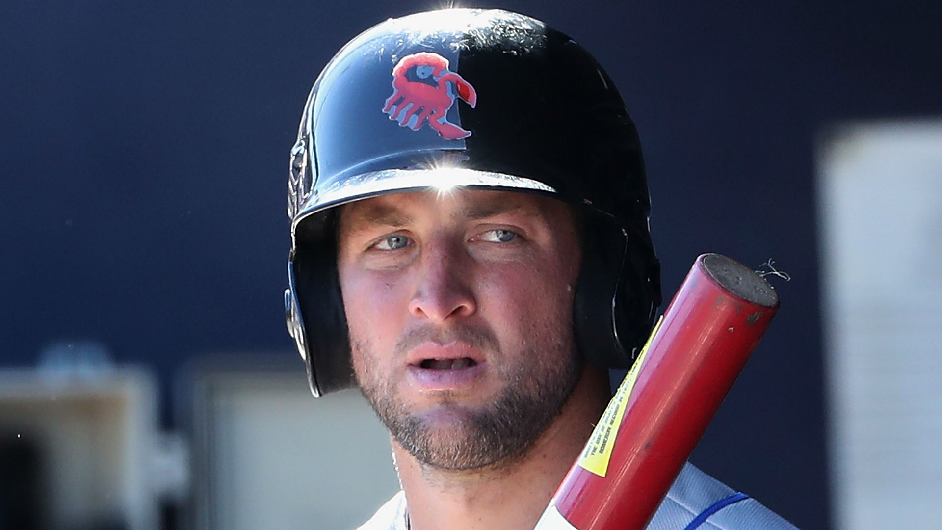 Tim Tebow hit by pitch in head with fastball, stays in game