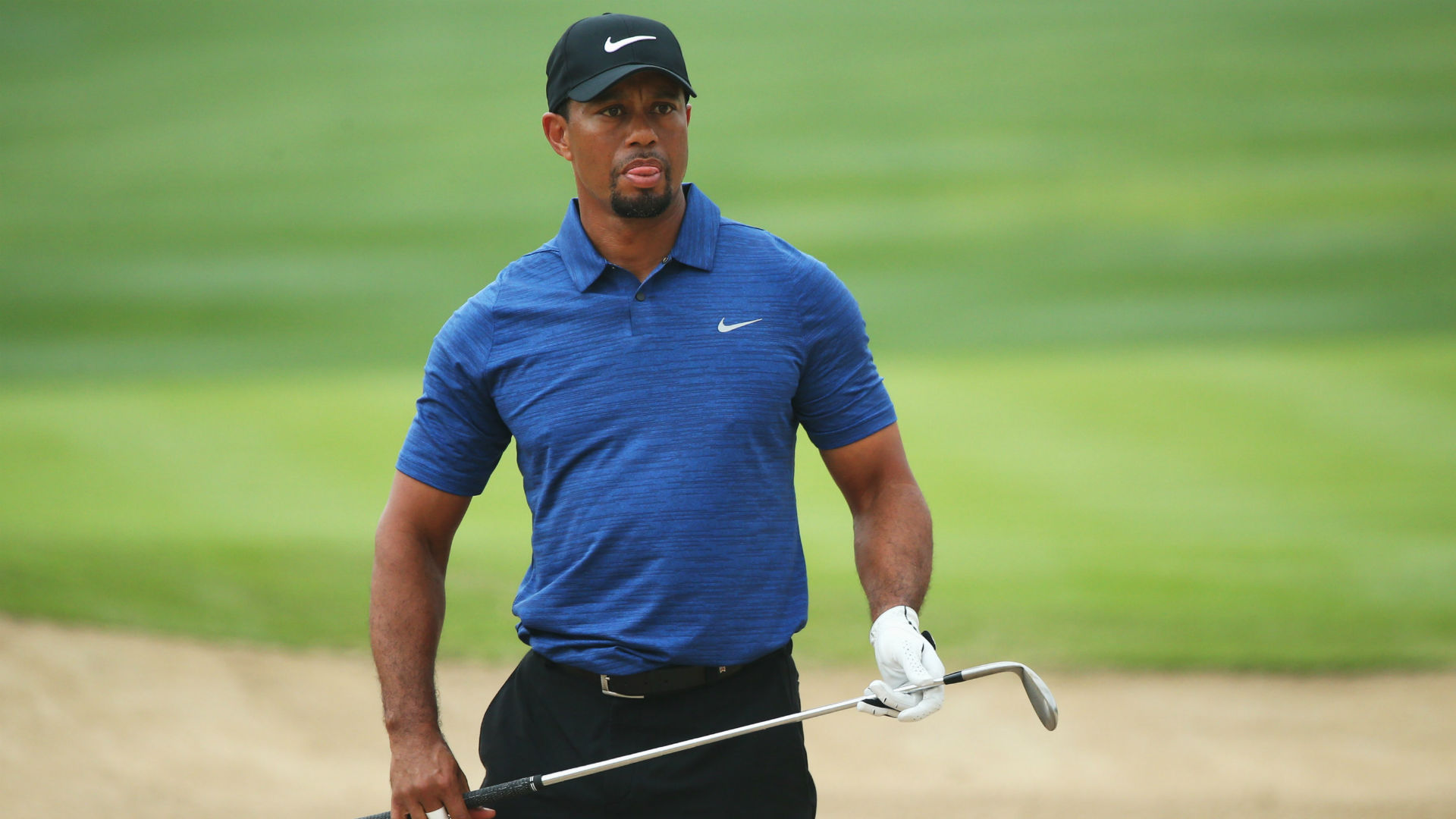 How old is Tiger Woods?