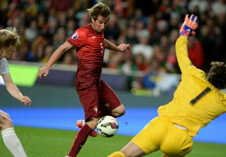 Coentrao sends Portugal top