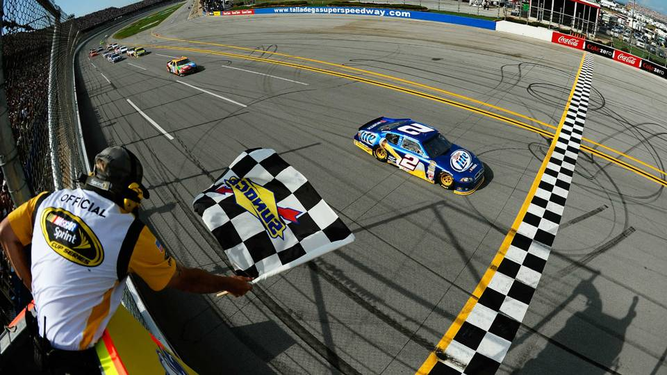 Brad Keselowski takes the checkered at Talladega.