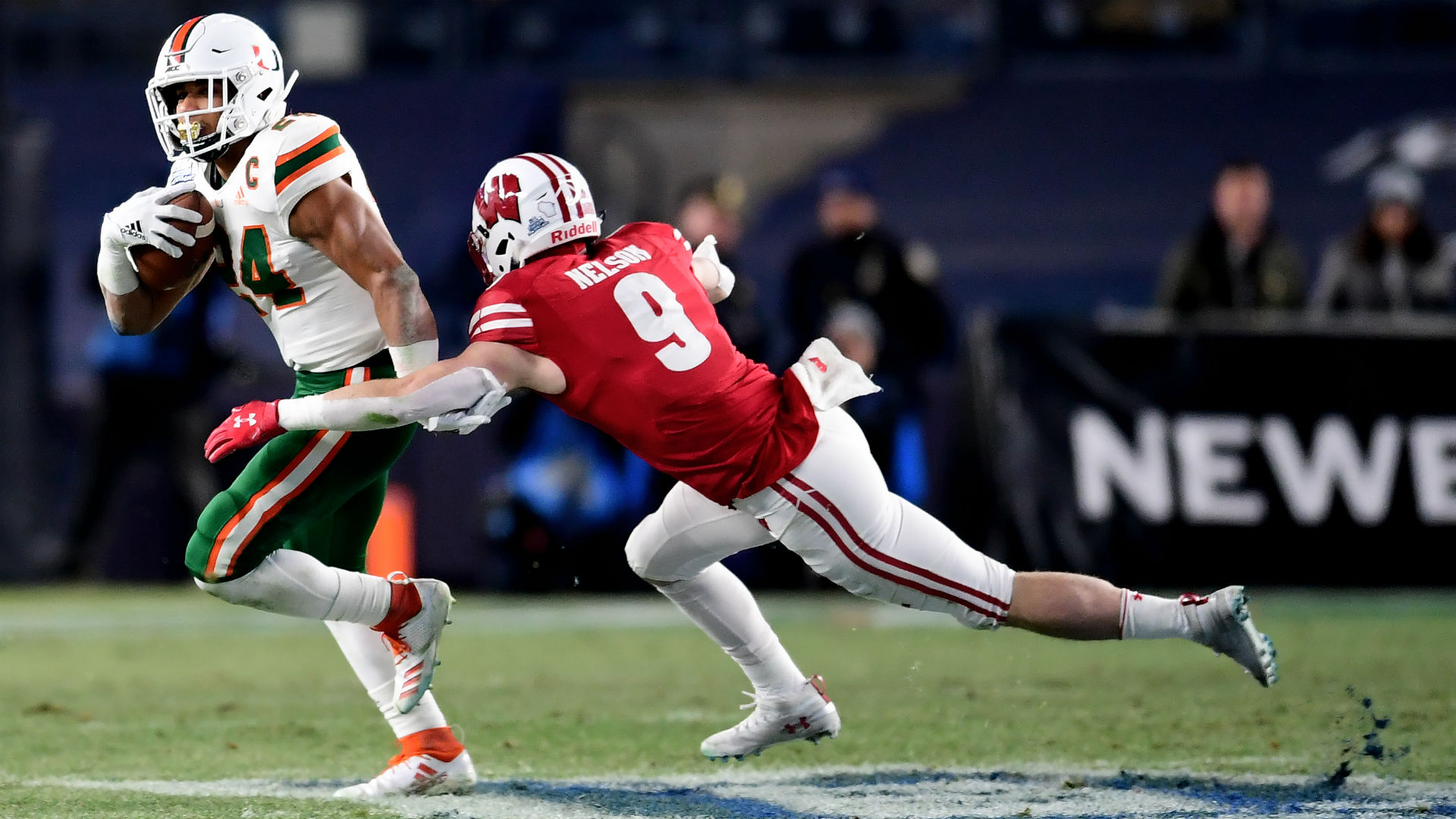 Taylor rushes for 205 yards in Wisconsin's Pinstripe victory