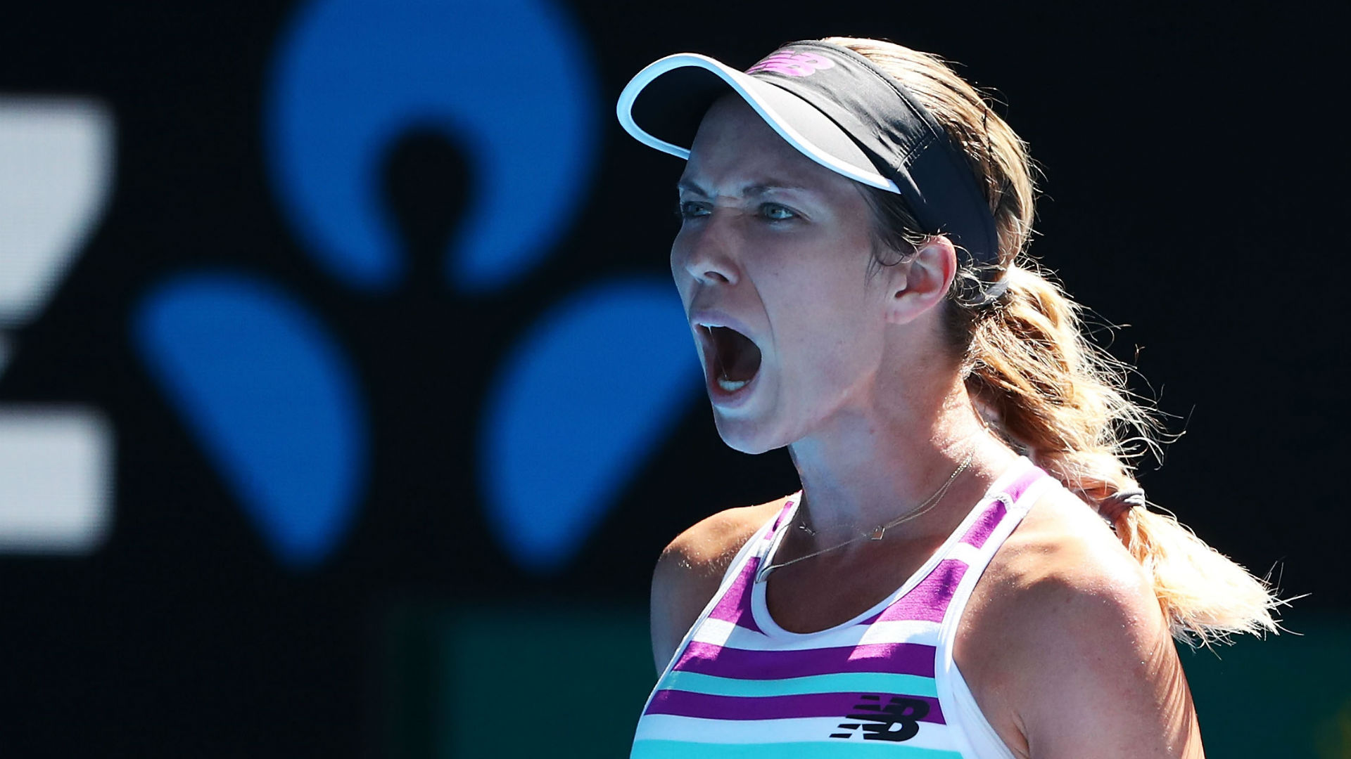 Collins stuns Kerber to breeze into Australian Open quarterfinals