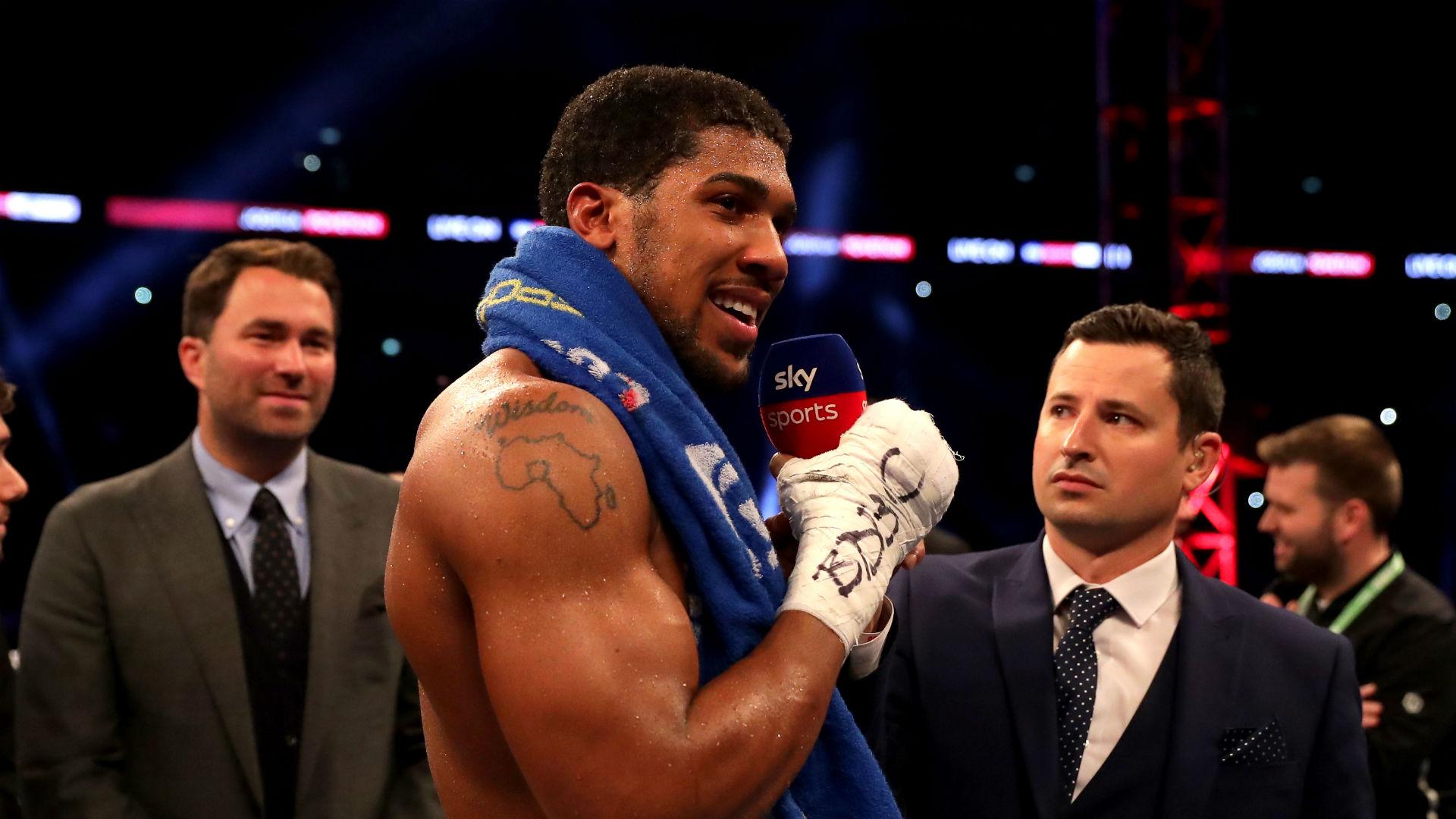 Anthony Joshua stops Povetkin to retain world heavyweight titles