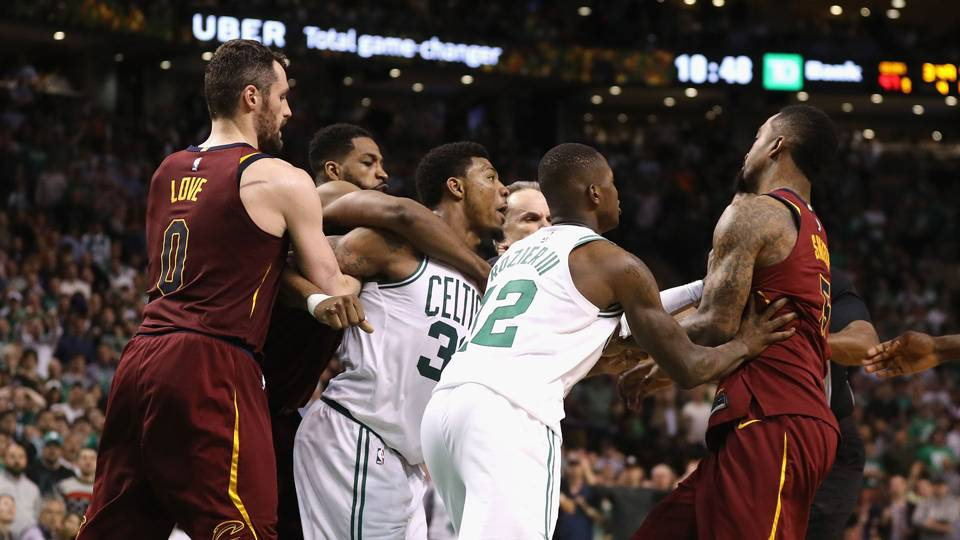 WATCH: Celtics' Marcus Smart has to be held back during confrontation with JR Smith in preseason matchup