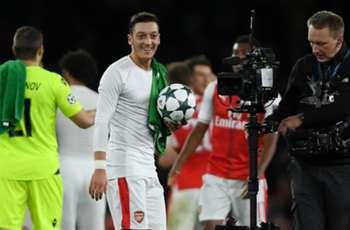 Arsenal defender Mertesacker hails 'hungry' hat-trick hero Ozil