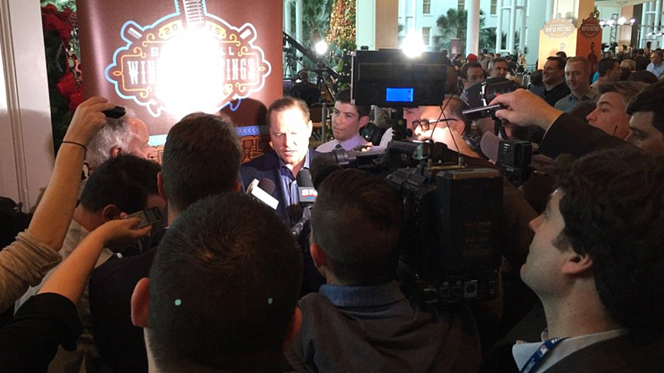 Agent Scott Boras surrounded by media
