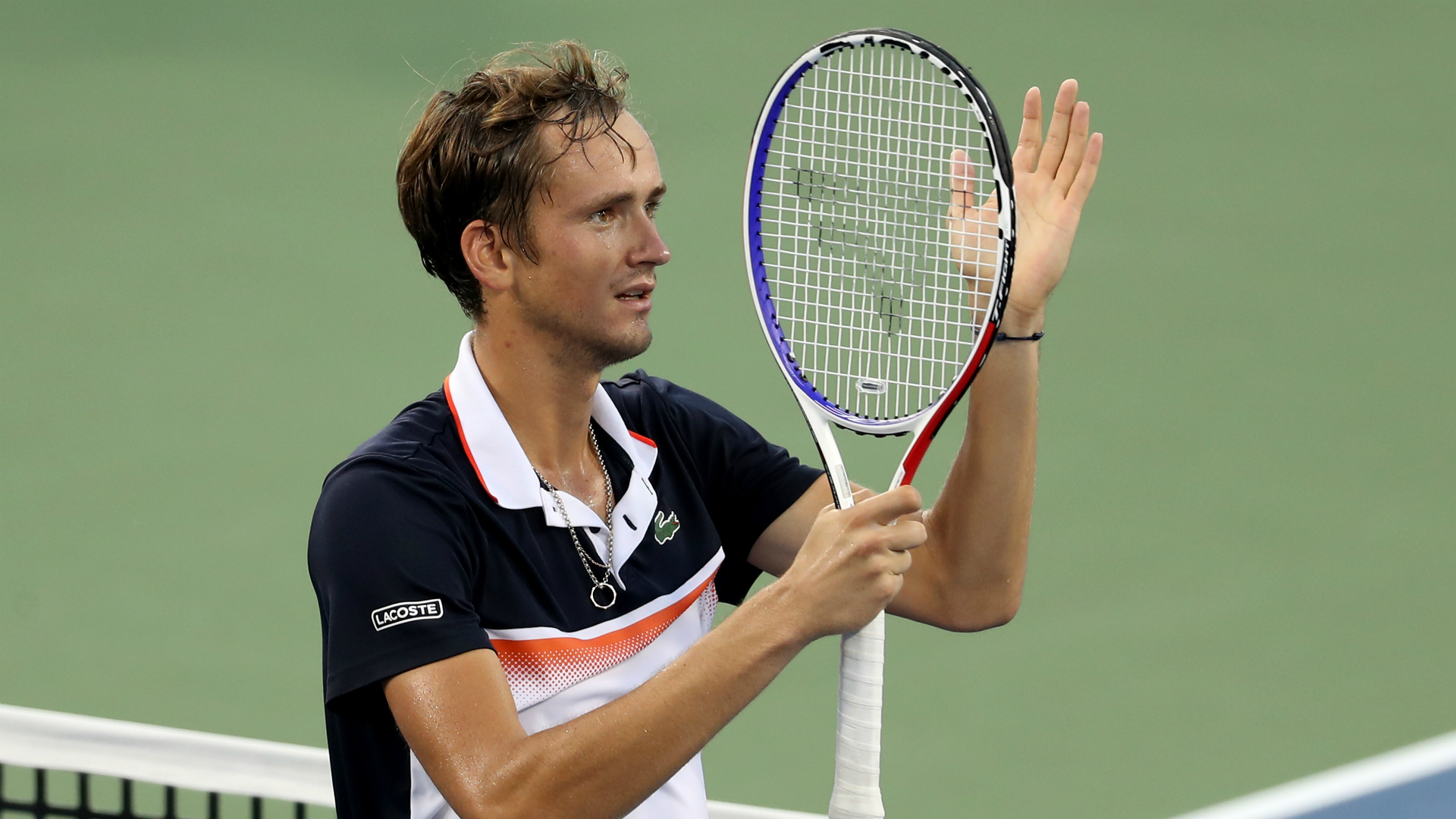 Daniil Medvedev celebrates his win over Novak Djokovic