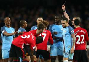 Marouane Fellaini is shown a red card for a headbutt on Sergio Aguero