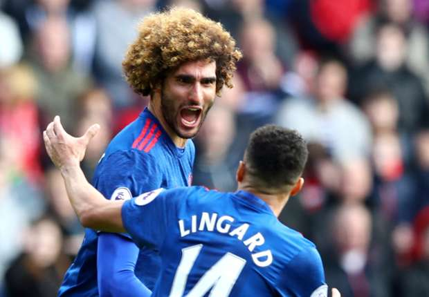 Marouane Fellaini celebrates with Jesse Lingard