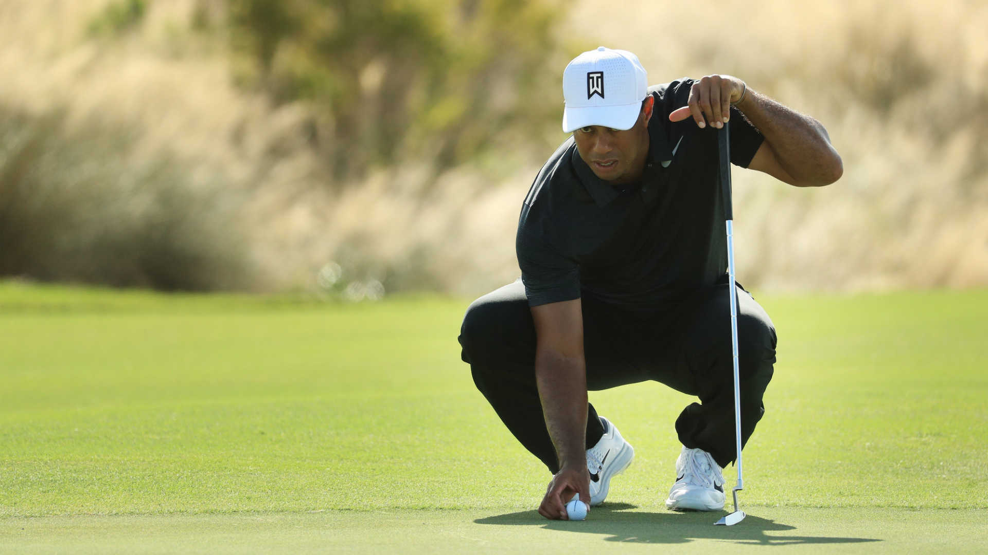 Emotional Tiger Woods shows flashes of his vintage game