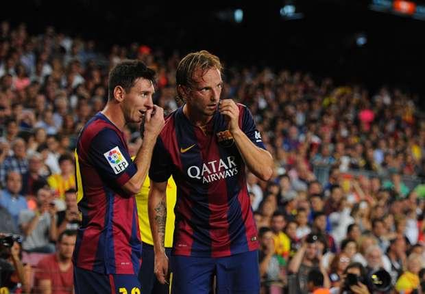 Barcelona team-mates Lionel Messi and Ivan Rakitic