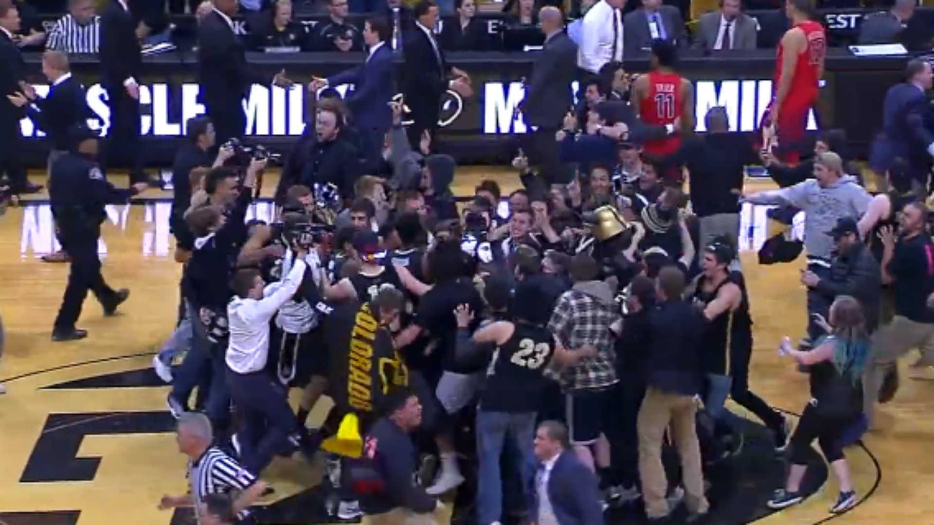 Colorado fans storm the floor.