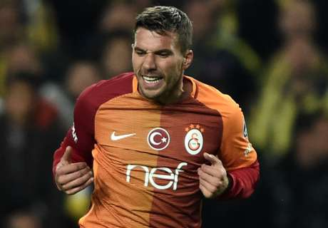 Podolski nets five in cup rout