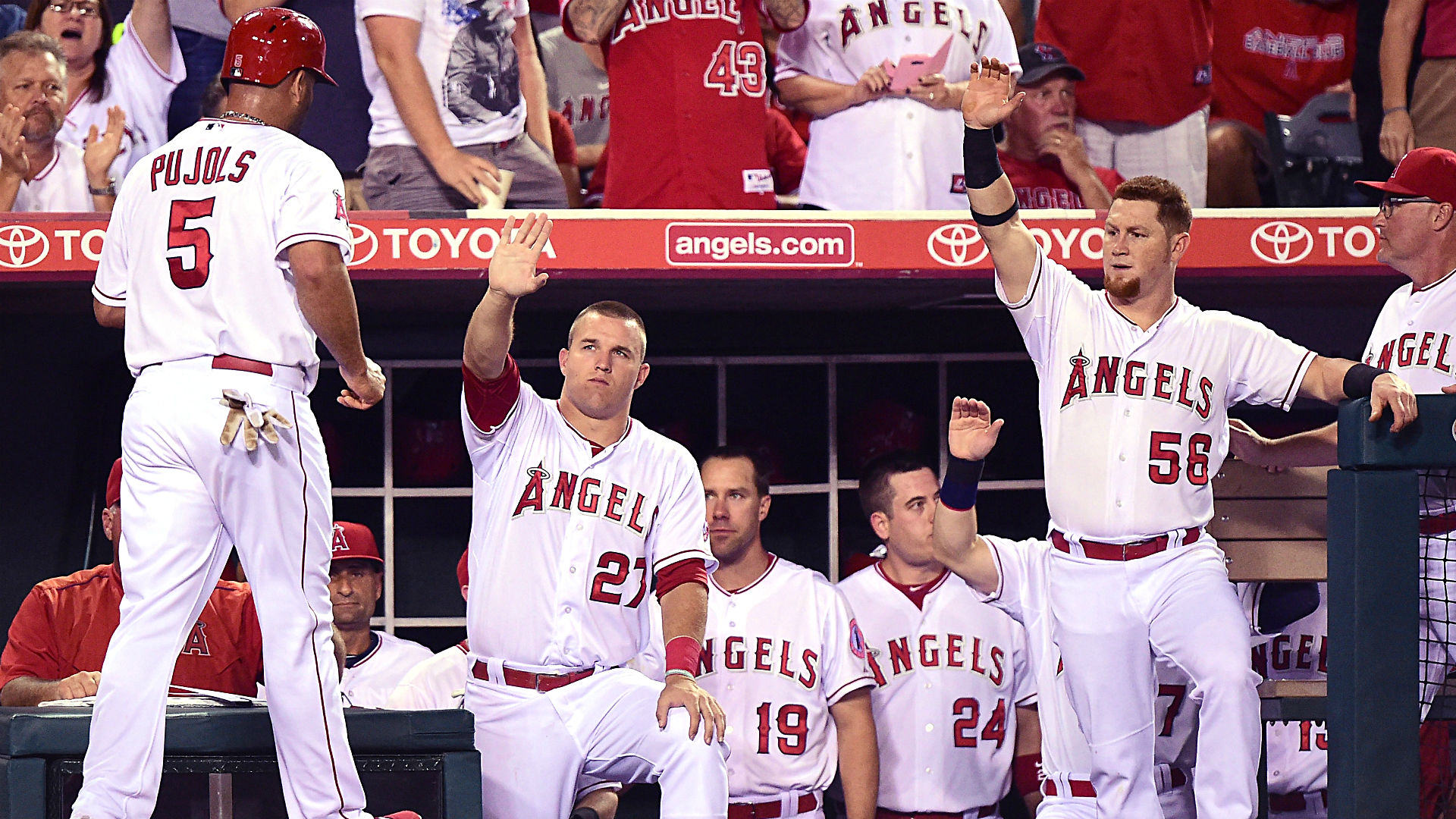 The Angels' Mike Trout, Kole Calhoun celebrate with Albert Pujols