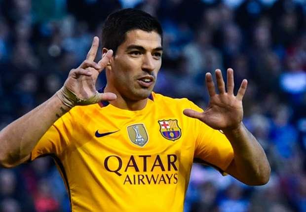 Suarez swings title race back in Barca's favour