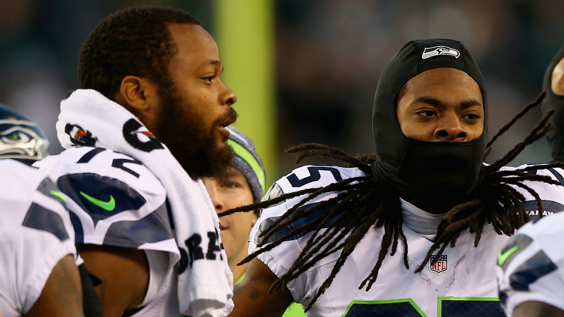Michael Bennett, left, with Richard Sherman