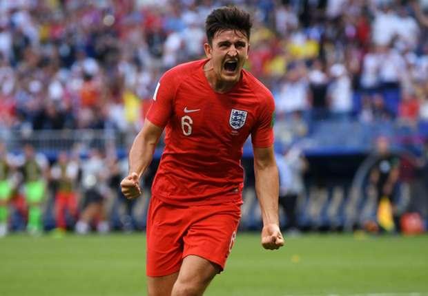 Harry Maguire celebrates England's opener against Sweden