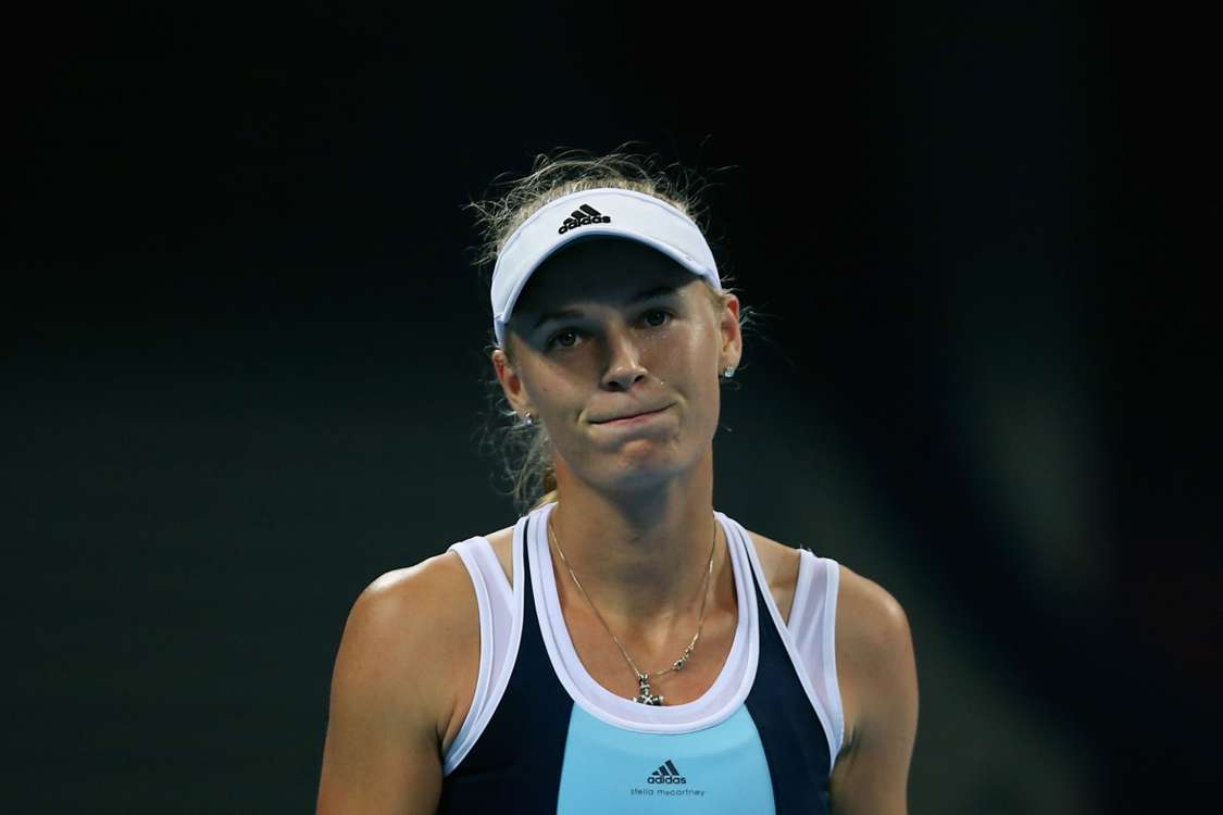 Wozniacki, Lisicki set up semi-final showdown
