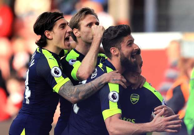 Arsenal players celebrate Mesut Ozil's goal against Stoke City
