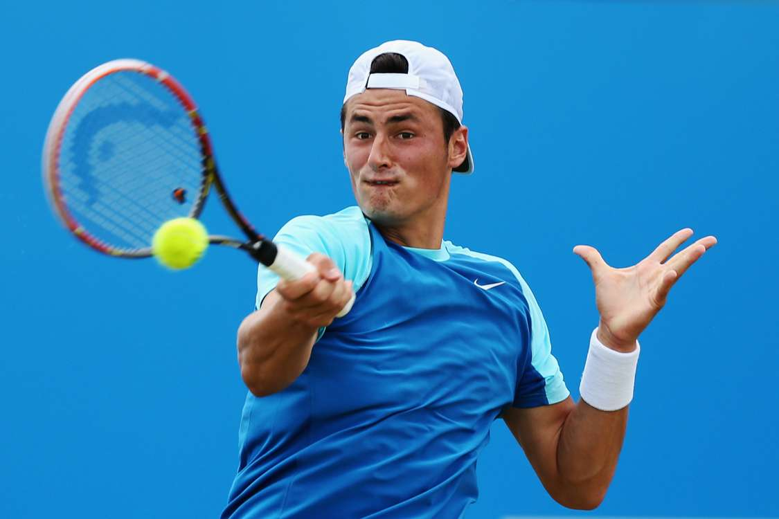 Tomic begins road to redemption with Dustov win