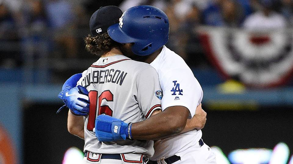 MLB Postseason 2018: Dodgers' Yasiel Puig kisses former teammate Charlie Culberson after being caught stealing