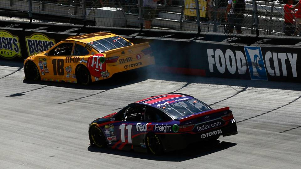 Kyle Busch tags the wall in the Food City 500
