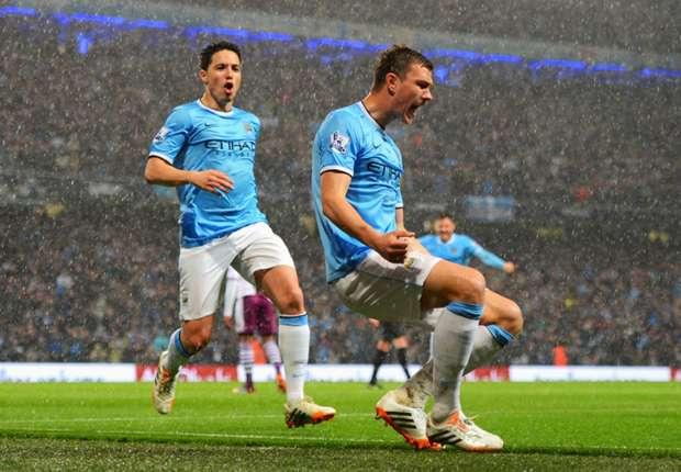Manchester City's Samir Nasri and Edin Dzeko