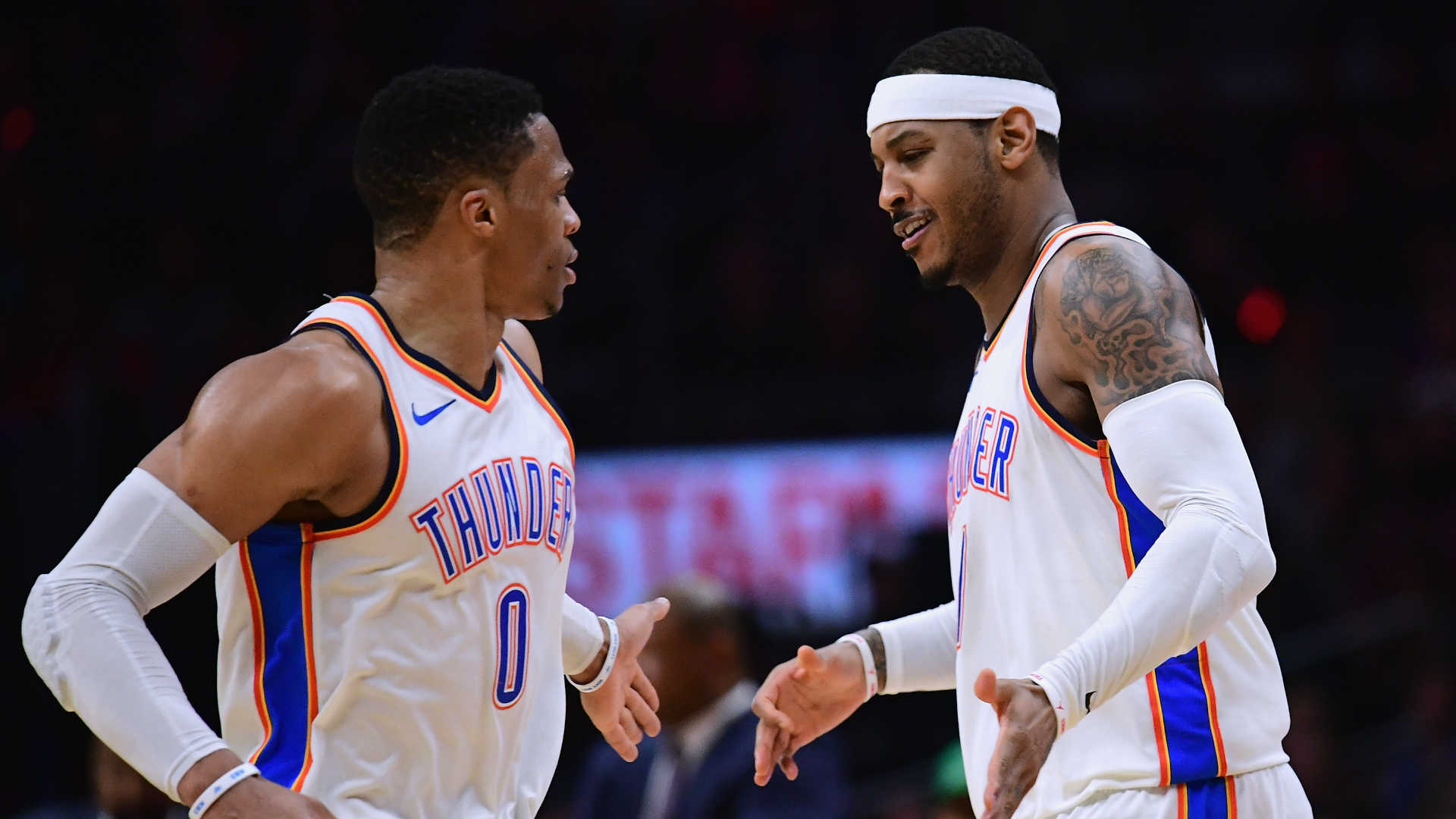 Russell Westbrook left and Carmelo Anthony